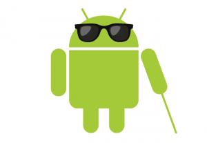 el muñeco verde de android con unas gafas de sol.